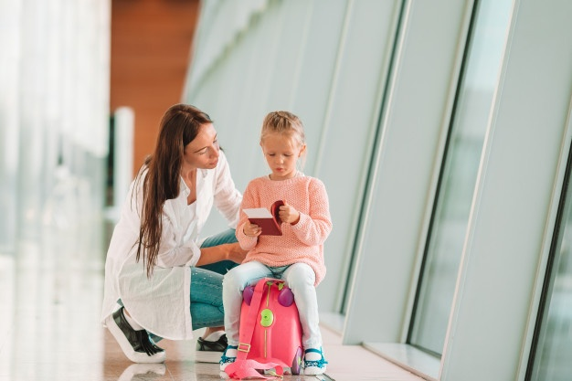 Mom and daughter at the airport
